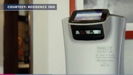 Social distancing robot delivering items to hotel guests