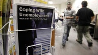 Number of Americans filing for jobless aid falls to 787,000, lowest since March