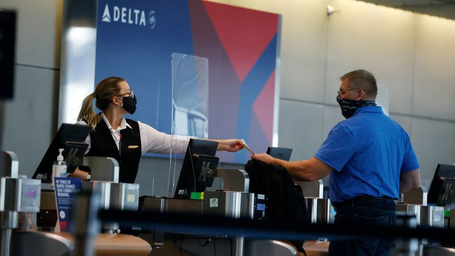 Delta flight returns to gate after two passengers refuse to wear masks