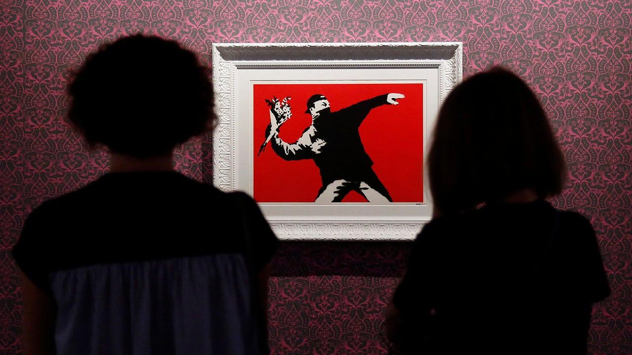 Banksy loses trademark in legal battle over 'Flower Thrower' art - Fox Business