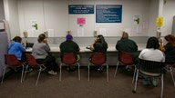 Another 870,000 Americans sought jobless aid as layoffs persist