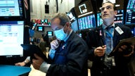 Stock futures turn lower as traders wait for stimulus