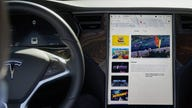Tesla charging up to develop its own in-vehicle video games