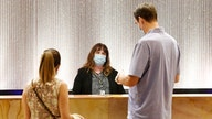 Hotel industry relaxes mask requirements for fully vaccinated guests