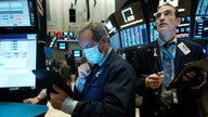 Stock futures trade lower ahead of jobless claims, retail earnings