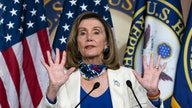 Pelosi pledges 'imminent' relief for US airlines, urges industry to delay thousands of furloughs