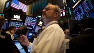 Dow down 300 points, Fed's Powell talks COVID-19 concerns
