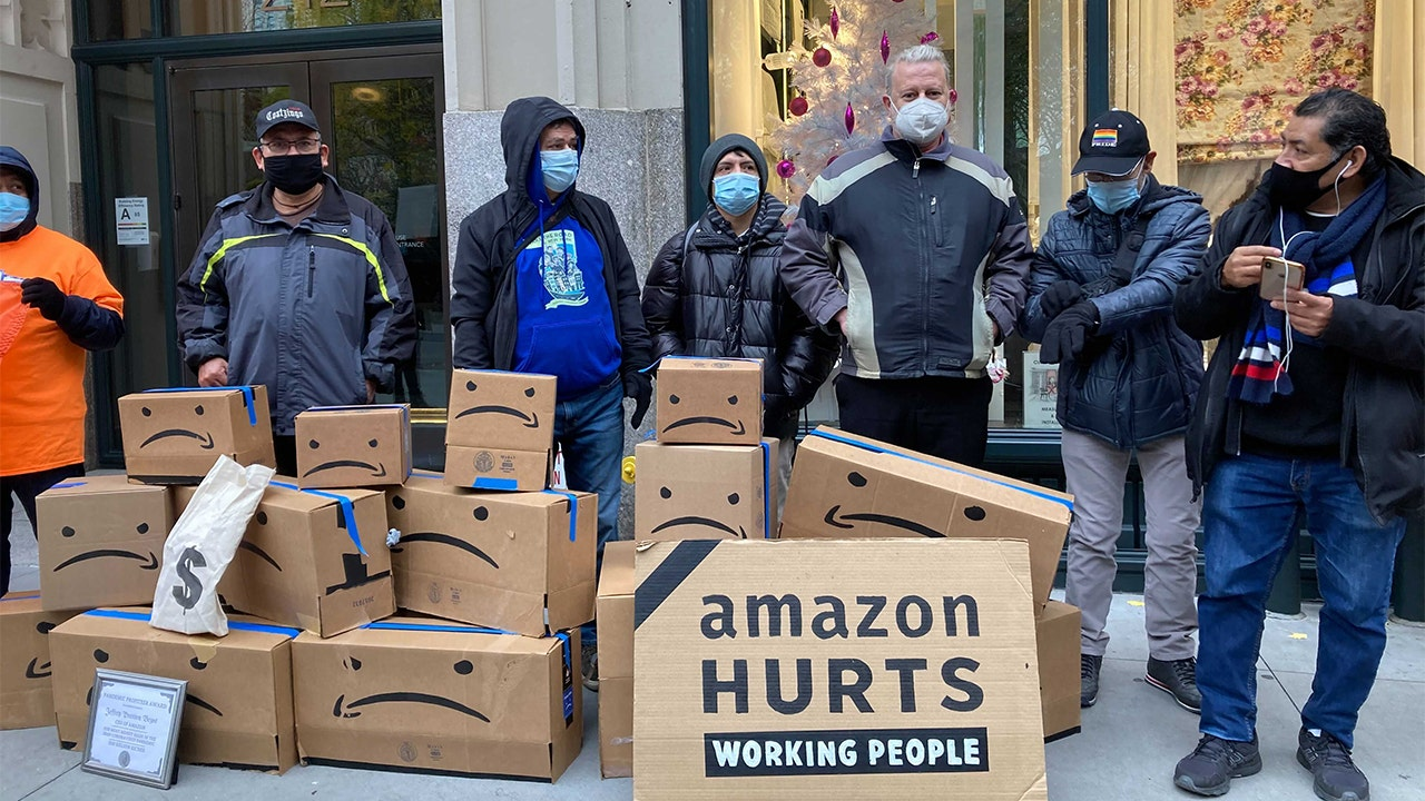 Amazon workers protest outside Jeff Bezos` NYC home...