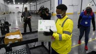 FedEx begins shipping second COVID-19 vaccine, with first Moderna shots expected Monday