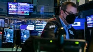 Futures little changed as barrage of earnings hits Wall Street