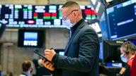 Stock futures trade lower ahead of Powell comments