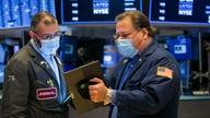 Stock futures trade higher on economic rebound optimism