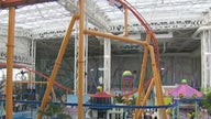 NY mall faces financial woes from theme-park investments, but vaccine rollout gives hope