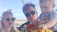 Elon Musk shares family photo with Grimes and baby X AE A-XII: 'Starbase, Texas'