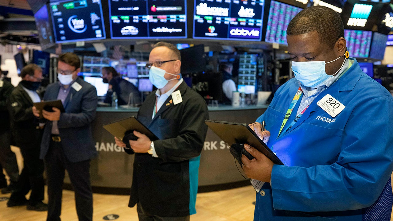 Dow closes above 34K for first time on jobs, retail bounce