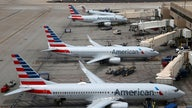 American Airlines posts $1.25B loss, delays new jets