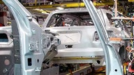Chip shortage forces more production cuts by GM, Ford