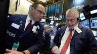 Stock futures trade lower ahead of economic data
