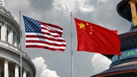 China, US commerce chiefs to cooperate on handling differences, Beijing says