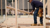 US housing starts drop sharply; building permits rise modestly