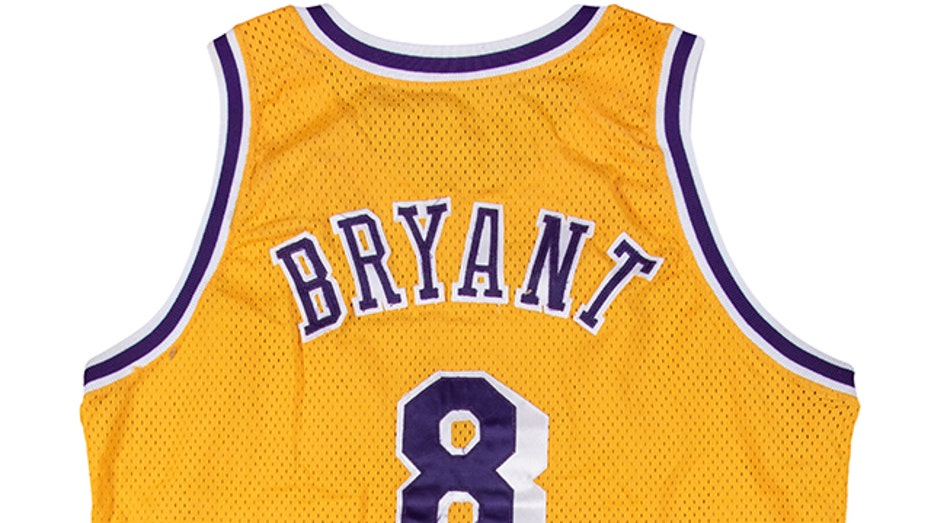 Kobe Bryant game-worn jersey from rookie season sold for record ...