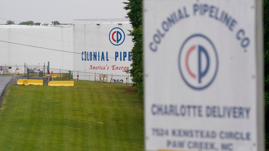The entrance of Colonial Pipeline Company is shown Wednesday, May 12, 2021, in Charlotte, N.C. Several gas stations in the Southeast reported running out of fuel, primarily because of what analysts say is unwarranted panic-buying among drivers, as the shutdown of a major pipeline by hackers entered its fifth day. (AP Photo/Chris Carlson)