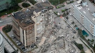Building collapse shows town's rich, middle-class division
