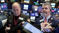 Stocks grind higher after Powell soothes inflation fears