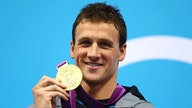 Olympic gold medalist Ryan Lochte disagrees with athletes who 'disgrace' American flag on the podium