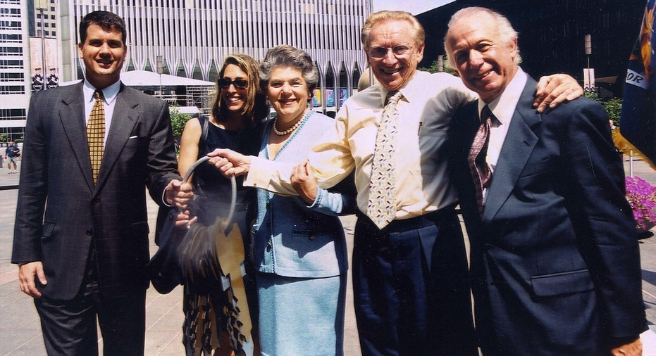 Larry Silverstein and his family pose for a photo after receiving the keys to 7 World Trade Center in 2001.