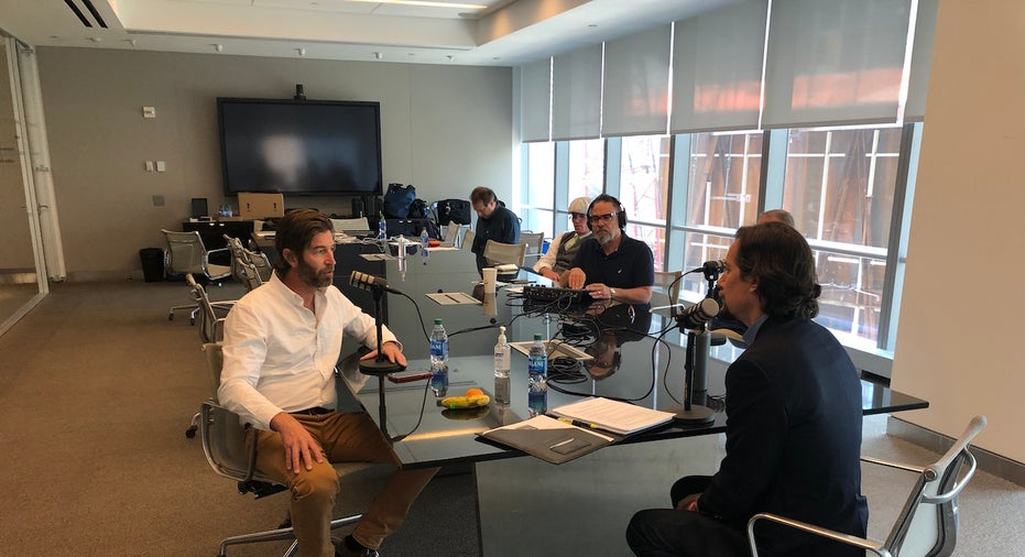 Silverstein Properties chief marketing officer and Top of the World host Dara McQuillan chats with National 9/11 Memorial architect Michael Arad