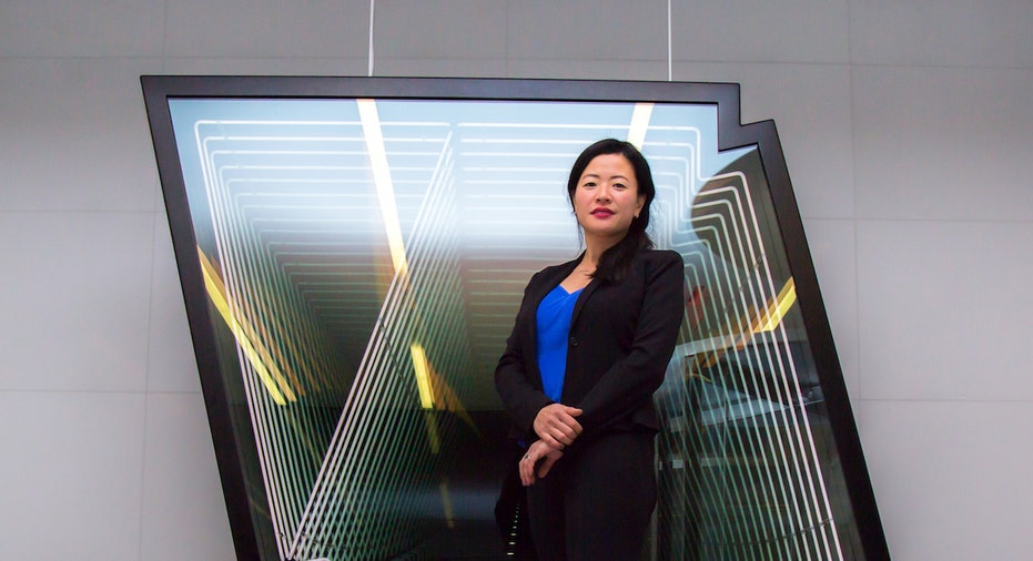 Silverstein Properties Vice President of Design Michiko Ashida poses in front of 4 World Trade Center art.