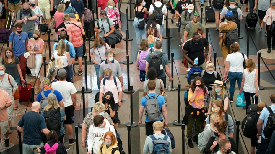 Denver International Airport crowded with passengers at security