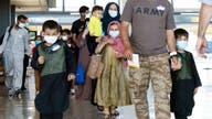 Afghanistan evacuation effort sparks bottleneck at Dulles Airport
