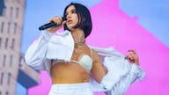 Dua Lipa rocks groovy two-piece causing it to sell out online