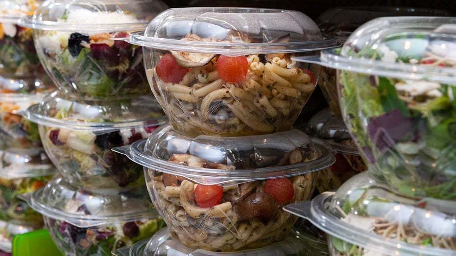Closeup shot of tasty food in plastic containers in the shop