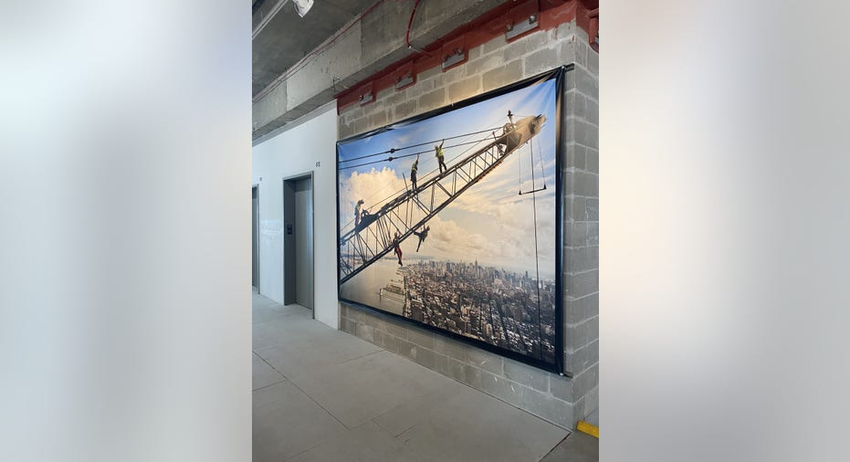 """""""Top of the World"""" exhibit tells the story of the World Trade Center's rebuilding efforts after the 9/11 terrorist attacks"""