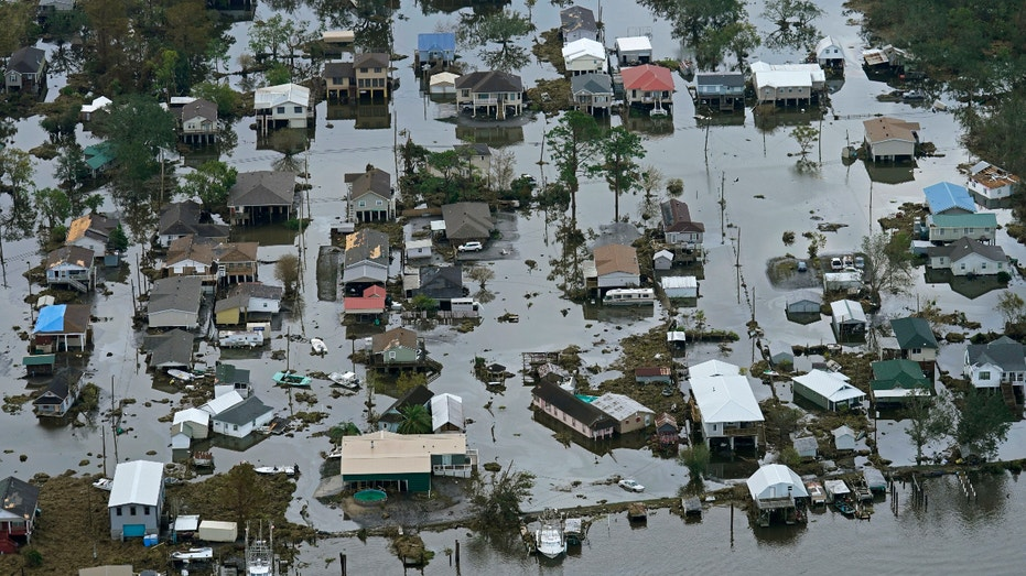 Floodwater slowly recedes in the aftermath of Hurricane Ida in Lafitte, La., Wednesday, Sept. 1, 2021. (AP Photo/Gerald Herbert)