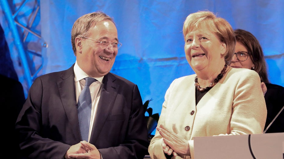Armin Laschet, chairman of the German Christian Democratic Union (CDU) and the party's top candidate for the federal election, left, and German chancellor Angela Merkel attend a joint campaign appearance in Stralsund, Germany
