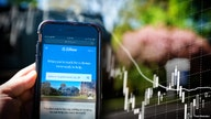 Zillow stock drops as company puts homebuying on hold