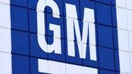 GM shares dip as profits fall