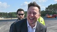 Tesla hits $1 trillion market value, Musk's net worth soars