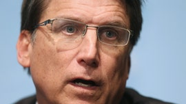Former North Carolina Gov. Pat McCrory says man looking like 'wrestler' smashed car with tree limb