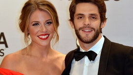 Thomas Rhett's wife Lauren Akins shows off baby bump at BMI Country Awards