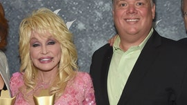 Dolly Parton posed at CMA Awards with former publicist Kirt Webster, gets slammed by sister Stella