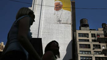 Risking arrest, more than 100 immigrant women walk 100 miles to meet pope