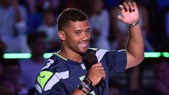 Russell Wilson gives glory to God after becoming NFL's highest-paid player