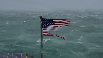 US flag seen shredded by Hurricane Florence being auctioned for Red Cross