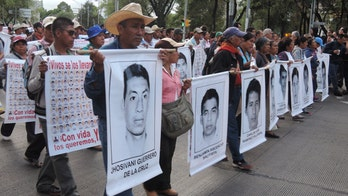 President Peña Nieto tries to calm Mexicans' increasing anger over violence, disappearances
