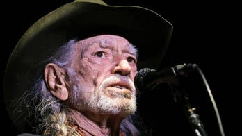 Willie Nelson signs, auctions off face masks gifted to him so that more PPE can be made